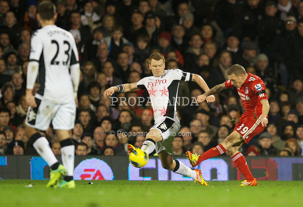 LONDON, ENGLAND - Monday, December 5, 2011: Liverpool's Craig Bellamy shoots under pressure from Fulham's John Arne Riise during the Premiership match at Craven Cottage. (Pic by David Rawcliffe/Propaganda)