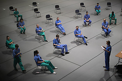 © Licensed to London News Pictures . 16/04/2020. Manchester, UK. New porters and cleaners at a hospital induction . The National Health Service has built a 648 bed field hospital for the treatment of Covid-19 patients , at the historical railway station terminus which now forms the main hall of the Manchester Central Convention Centre . The facility is due to open this week (ending Friday 17th April 2020 ) and will treat patients from across the North West of England , providing them with general medical care and oxygen therapy after discharge from Intensive Care Units . Photo credit : Joel Goodman/LNP