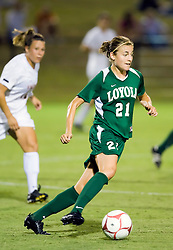 Loyola Greyhounds midfielder Colleen Kinealy (21) dribbles up field against UVA.  The #6 Virginia Cavaliers defeated the Loyola College Greyhounds 4-0 in a NCAA Women's Soccer game held at Klockner Stadium on the Grounds of the University of Virginia in Charlottesville, VA on August 22, 2008.