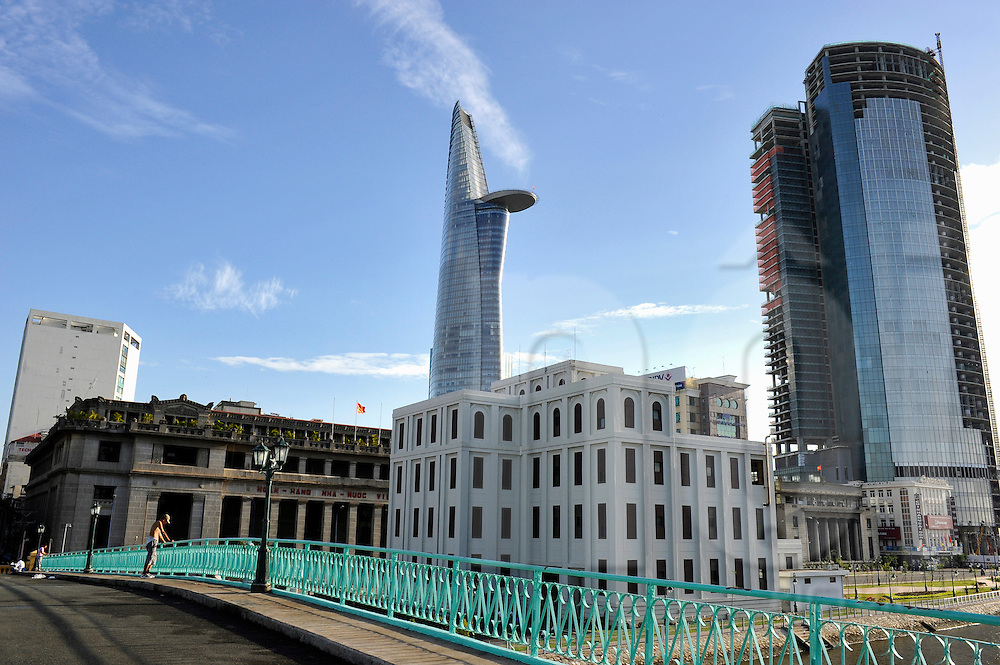 View of the State Bank of Vietnam and Bitexco Tower from Mong bridge, Ho Chi Minh City, Vietnam, Southeast Asia