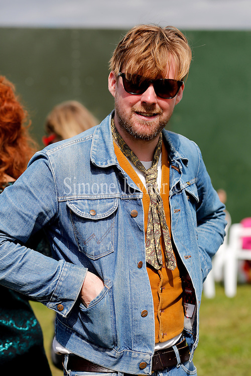 READING, ENGLAND - AUGUST 26:  Ricky Wilson of Kaiser Chiefs is seen backstage on Day Three during the Reading Festival 2012 at Richfield Avenue on August 26, 2012 in Reading, England.  (Photo by Simone Joyner/Getty Images)