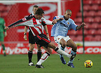 Photo: Lee Earle.<br /> Southampton v Hull City. Coca Cola Championship. 04/11/2006. Hull's Jason Jarrett (R) battles with Claus Lundekvam.
