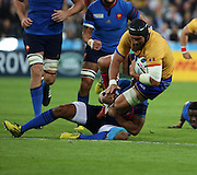 Valentin Ursache (Romania) being tackled after a bright Romanian attack during the Rugby World Cup Pool D match between France and Romania at the Queen Elizabeth II Olympic Park, London, United Kingdom on 23 September 2015. Photo by Matthew Redman.