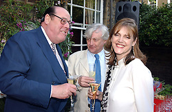 Left to right, the HON.NICHOLAS SOAMES and MR & MRS FRANK JOHNSON she is the mother of top model Honor Fraser and Lord Lovat at a Conservative Party summer garden party hosted by Lord Hesketh and held at 7 Lansdowne Road, Notting Hill, London W11 on 28th June 2004.