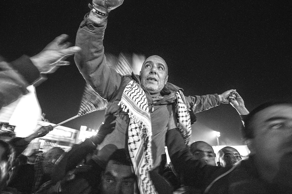 Palestinians celebrate the release of 26 men as part of peace negotiations with Israel. Dec. 31, 2013. West Bank, Palestine.