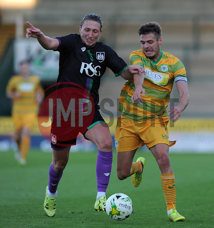 Yeovil Town's Ryan Dickson is tackled by Bristol City's Luke Ayling- Photo mandatory by-line: Harry Trump/JMP - Mobile: 07966 386802 - 30/07/15 - SPORT - FOOTBALL - Pre Season Fixture - Yeovil Town v Bristol City - Huish Park, Yeovil, England.