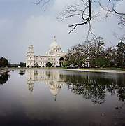 """Kolkata the Indian capital until 1912. Center of modern education, industry, science, culture and politics in India, since 1954, Kolkata has witnessed intense political violence, clashes and economic stagnation in the past..In the year 2001, economic rejuvenation has spurred on the city's growth with extensive urbanization, commercialization and job creation. .Kolkata boasts of Eastern India's only IT-hub, its Software sector growth by large growing in leaps and bounds transforming Kolkata as one of the Hotbeds of Indian IT Industry, that has one of the fastest developing corporate sectors..I tried to show the two different souls of the city: """" Calcutta """" showing the old city as we always saw it. """" Kolkata """"  showing the new city,  the new colors and atmospheres and the result of the high-rises, luxurious condominiums, row houses and shopping mall. Sunday morning at Victoria Memorial Park, Kolkata, India on Feb. 25, 2010."""