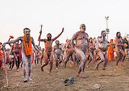 Naga Sadhu from Juna Akhara going to bath, Maha Kumbh Mela festival, world's largest congregation of religious pilgrims. Allahabad, India.
