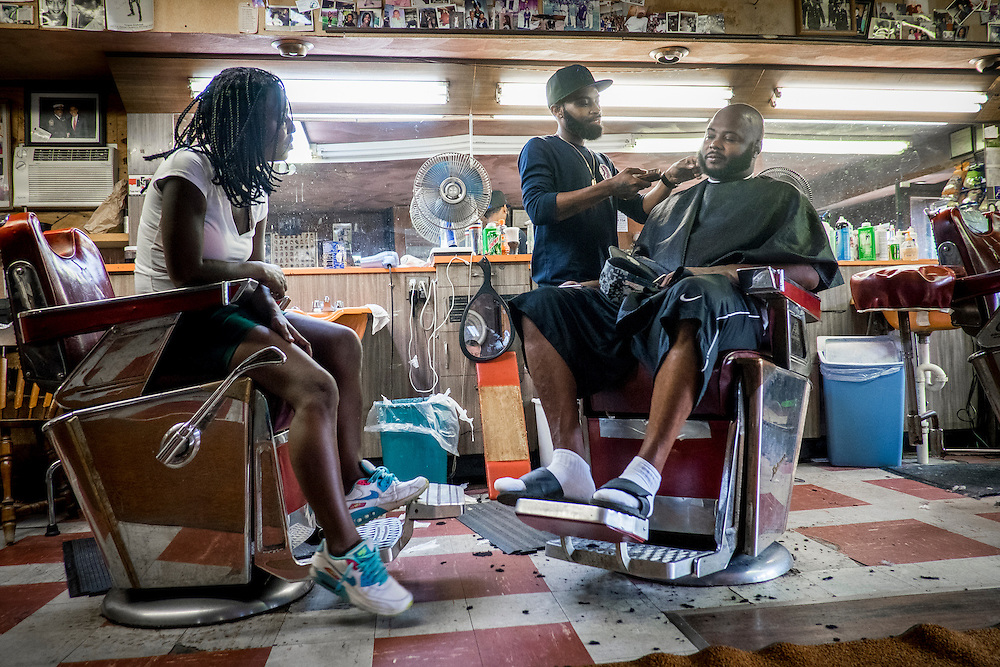 Shawn Murphy cuts hair at Bert's Barber Shop in Aliquippa. Pa., a mainstay of the community since 1966.