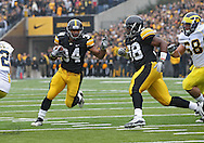 November 05, 2011: Iowa Hawkeyes running back Marcus Coker (34) on a run during the first quarter of the NCAA football game between the Michigan Wolverines and the Iowa Hawkeyes at Kinnick Stadium in Iowa City, Iowa on Saturday, November 5, 2011. Iowa defeated Michigan 24-16.