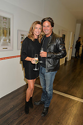 TINA HOBLEY and OLIVER WHEELER at the YOO 15 Anniversary Party hosted by John Hitchcox and Philippe Starck at Bankside, SE1 on 17th September 2014