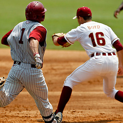 June 06, 2011; Tallahassee, FL, USA; Florida State Seminoles first baseman Jayce Boyd (16) gets the force out on Alabama Crimson Tide center fielder Taylor Dugas (1)  during the eighth inning of the Tallahassee regional of the 2011 NCAA baseball tournament as play resumed following the suspension of play due to severe weather last night at Dick Howser Stadium. Florida State defeated Alabama 11-1 to advance to a super regional.  Mandatory Credit: Derick E. Hingle