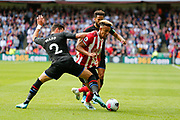 Joel Ward of Crystal Palace challenges Callum Robinson of Sheffield United during the Premier League match between Sheffield United and Crystal Palace at Bramall Lane, Sheffield, England on 18 August 2019.