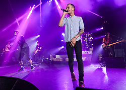 """© Licensed to London News Pictures. 01/03/2014. London, UK.   Rizzle Kicks performing live at Hammersmith Apollo. In this picture - Jordan Stephens (left), Harvley Alexander-Sule (centre).  Rizzle Kicks are an English hip hop duo from Brighton, consisting of Jordan """"Rizzle"""" Stephens and Harley """"Sylvester"""" Alexander-Sule.   Photo credit : Richard Isaac/LNP"""