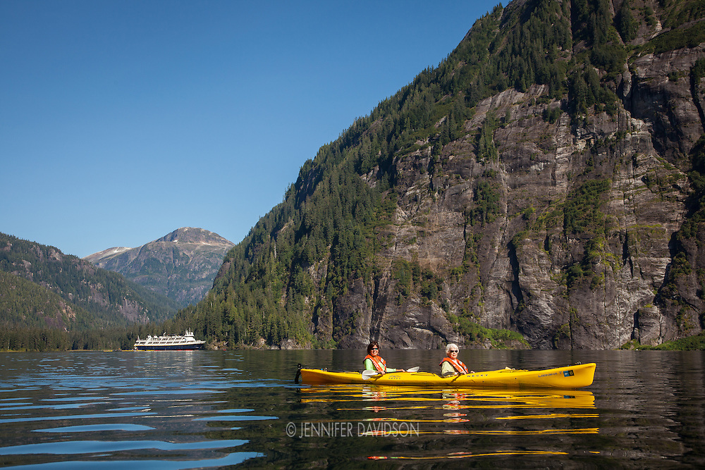 Guests from the National Geographic Sea Lion kayak in the Misty Fjords National Monument, Alaska.