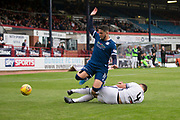 14th September 2019; Dens Park, Dundee, Scotland; Scottish Championship, Dundee Football Club versus Alloa Athletic; Declan McDaid of Dundee is tackled by Robbie Deas of Alloa Athletic