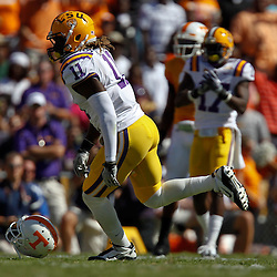 Oct 2, 2010; Baton Rouge, LA, USA; LSU Tigers linebacker Kelvin Sheppard (11) celebrates after sacking Tennessee Volunteers quarterback Matt Simms and knocking off his helmet during the first half at Tiger Stadium.  Mandatory Credit: Derick E. Hingle