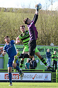 North Ferriby United goalkeeper Rory Watson (1) catches the ball ahead of Forest Green Rovers forward Christian Doidge (9) 0-1 during the Vanarama National League match between Forest Green Rovers and North Ferriby United at the New Lawn, Forest Green, United Kingdom on 1 April 2017. Photo by Alan Franklin.
