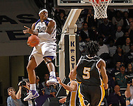 Kansas State forward Bill Walker (12) goes air born as he makes a pass to back onto the court against Kennesaw State in the first half at Bramlage Coliseum in Manhattan, Kansas, December 17, 2006.  K-State beat Kennesaw State 82-54.<br />