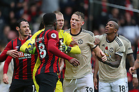 Football - 2019 / 2020 Premier League - AFC Bournemouth vs. Manchester United<br /> <br /> Tempers boil over between Bournemouth's Jefferson Lerma and Scott McTominay of Manchester United as goalkeeper Aaron Ramsdale tries to keep the two apart during the Premier League match at the Vitality Stadium (Dean Court) Bournemouth  <br /> <br /> COLORSPORT/SHAUN BOGGUST