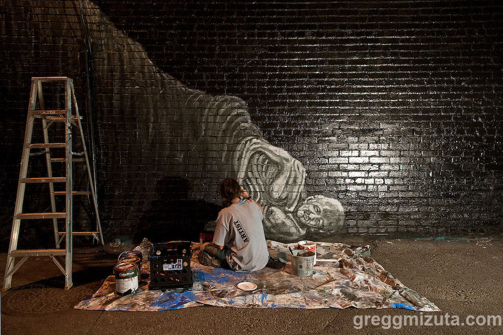 Carlos Lee Sullivan works on his mural in the evening of August 8, 2016 during the Freak Alley Gallery sixth annual mural event in downtown Boise, Idaho.<br /> <br /> Freak Alley Gallery's week long event provided an &quot;art-in-motion&quot; experience as it welcomed the public to watch artists work on their murals.