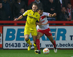 STEVENAGE, ENGLAND - Saturday, November 24, 2012: Tranmere Rovers' Adam McGurk in action against Stevenage's Darius Charles during the Football League One match at Broadhall Way. (Pic by David Rawcliffe/Propaganda)
