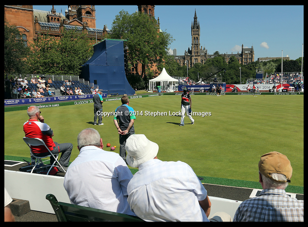 Image licensed to i-Images Picture Agency. 25/07/2014. Glasgow, United Kingdom. Spectators enjoy the hot weather as they watch the  Lawn Bowls competition  at the Kelvingrove Bowls Centre during day two of Commonwealth Games in Glasgow.  Picture by Stephen Lock / i-Images