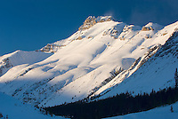 Nigel Peak bathed in the light of a winter sunset, Jasper National Park Alberta Canada