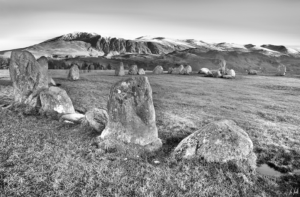 Castlerigg Stone Circle (alt. Keswick Carles, Carles, Carsles or Castle-rig) near Keswick in England is one of the most visually impressive prehistoric monuments in Britain and is the most visited stone circle in Cumbria.[1] Every year, thousands of people make the short journey from Keswick to the plateau of Castlerigg Fell and to Chestnut Hill, on which the monument stands. This plateau forms the raised centre of a natural amphitheatre created by the surrounding fells and from within the circle it is possible to see some of the highest peaks in Cumbria: Helvellyn, Skiddaw, Grasmoor and Blencathra.