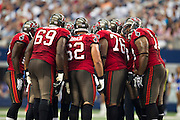 DALLAS, TX - SEPTEMBER 23:  Tampa Bay Buccaneers offense in the huddle during a game against the Dallas Cowboys at Cowboys Stadium on September 23, 2012 in Dallas, Texas.  The Cowboys defeated the Buccaneers 16-10.  (Photo by Wesley Hitt/Getty Images) *** Local Caption ***