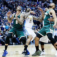 03 February 2016: Denver Nuggets forward Wilson Chandler (21) vies for the rebound with Milwaukee Bucks forward Michael Beasley (9), Milwaukee Bucks forward Jabari Parker (12) and Denver Nuggets guard Jameer Nelson (1) during the Denver Nuggets 121-117 victory over the Milwaukee Bucks, at the Pepsi Center, Denver, Colorado, USA.