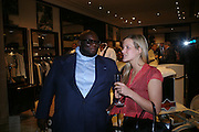 Ade and Clementine Brown. Party to celebrate Alfred Dunhill at the Goodwood Festival of Speed. Dunhill shop. 48 Jermyn St. London SW1. 9 June 2005. ONE TIME USE ONLY - DO NOT ARCHIVE  © Copyright Photograph by Dafydd Jones 66 Stockwell Park Rd. London SW9 0DA Tel 020 7733 0108 www.dafjones.com