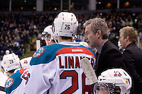 KELOWNA, CANADA, DECEMBER 27: Cole Linaker #26 of the Kelowna Rockets listens to coach Kim Dillabaugh on the bench opposite the Spokane Chiefs at the Kelowna Rockets on December 7, 2011 at Prospera Place in Kelowna, British Columbia, Canada (Photo by Marissa Baecker/Getty Images) *** Local Caption ***