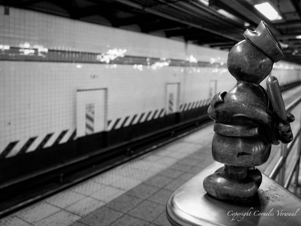 Policeman from Tom Otterness' installation Life Underground at the 14th Street – Eighth Avenue subway station.