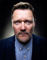 In this portrait of Ian Puleston-Davies the photographer has used wide angle lens to distort perspective and elongate the Actors face for a dramatic intense look