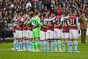 The Aston Villa players line up for a minutes silence during the Premier League match between Wolverhampton Wanderers and Aston Villa at Molineux, Wolverhampton, England on 10 November 2019.