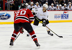 February 8, 2008; Newark, NJ, USA;  Anaheim Ducks defenseman Scott Niedermayer (27) takes a shot while being defended by New Jersey Devils left wing Jay Pandolfo (20) during the third period at the Prudential Center in Newark, NJ. The Anaheim Ducks defeated the New Jersey Devils by a 2-1 margin.