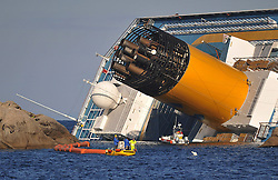 "Rubber booms being placed around the The Wrecked Cruise Ship ""Costa Concordia"" in Giglio, Italy, Photo By Nick Cornish/ I-Images."