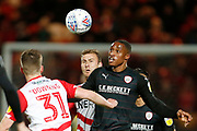 Barnsley forward Victor Adeboyejo (29) and Paul Downing of Doncaster Rovers contest a loose ball  during the EFL Sky Bet League 1 match between Doncaster Rovers and Barnsley at the Keepmoat Stadium, Doncaster, England on 15 March 2019.