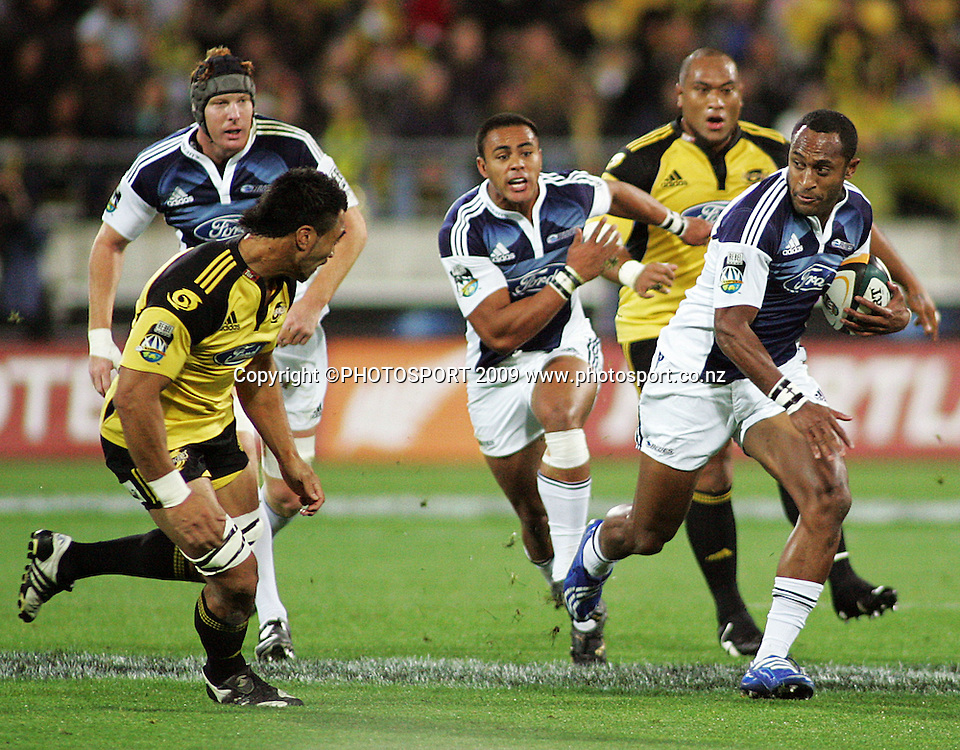 Hurricanes flanker Victor Vito chases Joe Rokocoko as Blues lock Jay Williams and fullback Rudi Wulf run in support.<br /> Super 14 rugby union match - Hurricanes v Blues, Westpac Stadium, Wellington, New Zealand. Friday 1 May 2009. Photo: Archie Simmons/PHOTOSPORT