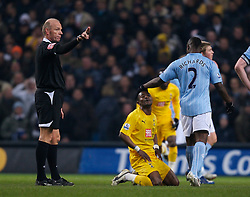MANCHESTER, ENGLAND - Tuesday, December 18, 2007: Tottenham Hotspur's Didier Zakora looks dejected as referee Steve Bennett shows him the red card and sends him off against Manchester City during the League Cup Quarter Final match at the City of Manchester Stadium. (Photo by David Rawcliffe/Propaganda)
