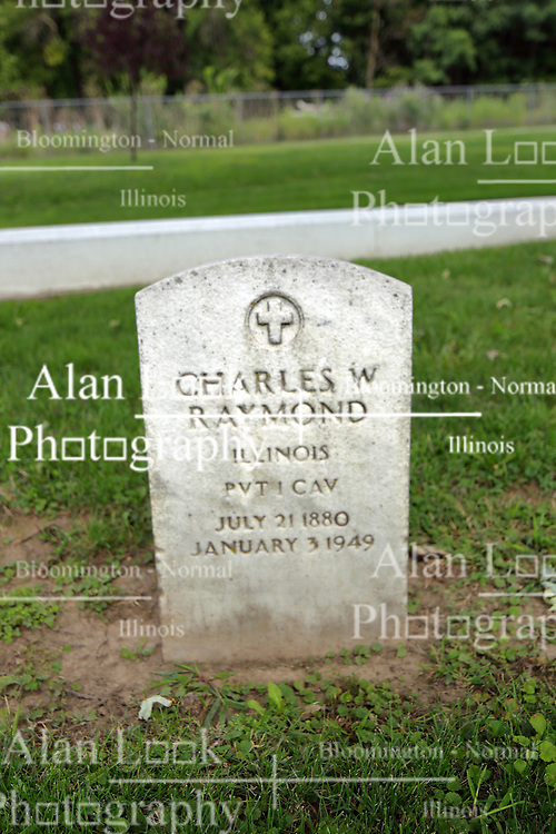 26 August 2017:   A part of the History of McLean County Illinois.<br /> <br /> Tombstones in Evergreen Memorial Cemetery.  Civic leaders, soldiers, and other prominent people are featured. Section 5, the old town soldiers area<br /> Charles W Raymond  Illinois Private 1 CAV  July 21 1880  January 3 1949