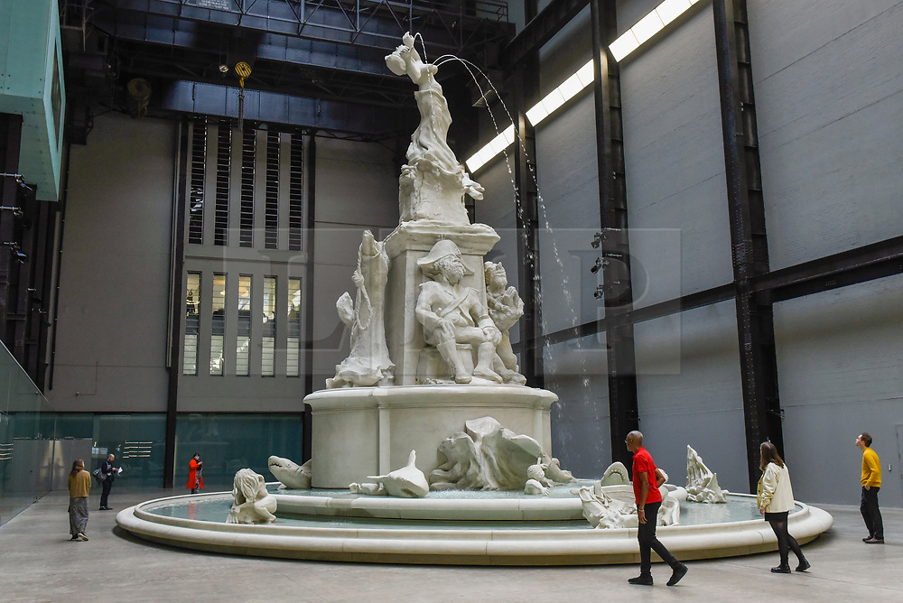 "© Licensed to London News Pictures. 30/09/2019. LONDON, UK.  Preview of ""Fons Americanus"" by Kara Walker, which has been unveiled as this year's Hyundai Commission at Tate Modern.  The work is a monumental 13 metre-high fountain presenting the origin story of the African diaspora and includes sculptural figures derived from an array of historical, literary and cultural sources.  The work, also inspired by the Victoria Memorial outside Buckingham Palace, is on display 2 October to 5 April 2020.  Photo credit: Stephen Chung/LNP"