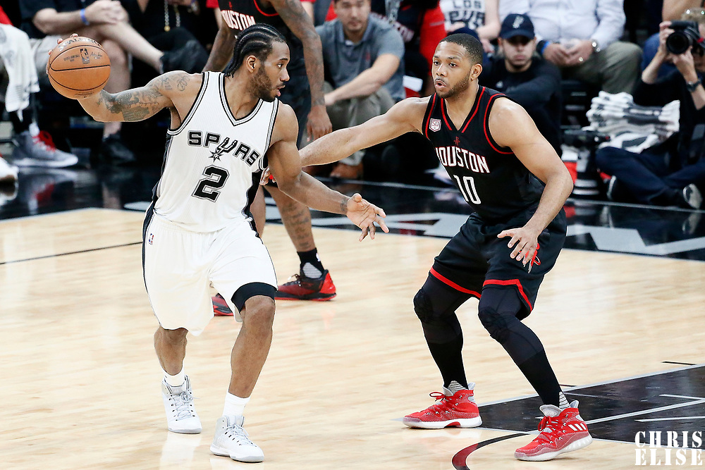 03 May 2017: Houston Rockets guard Eric Gordon (10) defends on San Antonio Spurs forward Kawhi Leonard (2) during the San Antonio Spurs 121-96 victory over the Houston Rockets, in game 2 of the Western Conference Semi Finals, at the AT&T Center, San Antonio, Texas, USA.