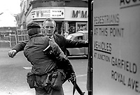 Soldiers on security duty in the run-up to Christmas 1972 routinely search shoppers, workers, etc, visiting the city centre in Belfast, N Ireland, December 1972. Generally it is endured with a mixture of stoicism and indifference, 197212070766d<br />