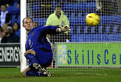 WIGAN, ENGLAND - Tuesday, January 4, 2005: Wolverhampton Wanderers' goalkeeper Michael Oakes is beaten from the penalty spot by Wigan's Nathan Ellington during the League Championship match at the JJB Stadium. (Pic By Dave Kendall/Propaganda)