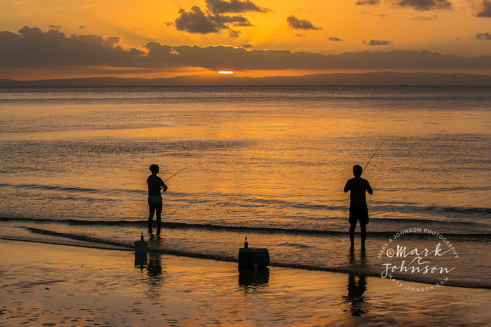 Couple fishing at sunset, Tangalooma, Moreton Island, Queensland, Australia