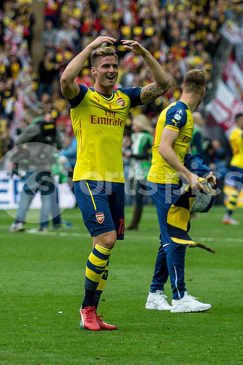 Oliver Giroud of Arsenal celebrates after the The FA Cup Final match between Arsenal and Aston Villa at Wembley Stadium, London, England on 30 May 2015. Photo by Liam McAvoy.