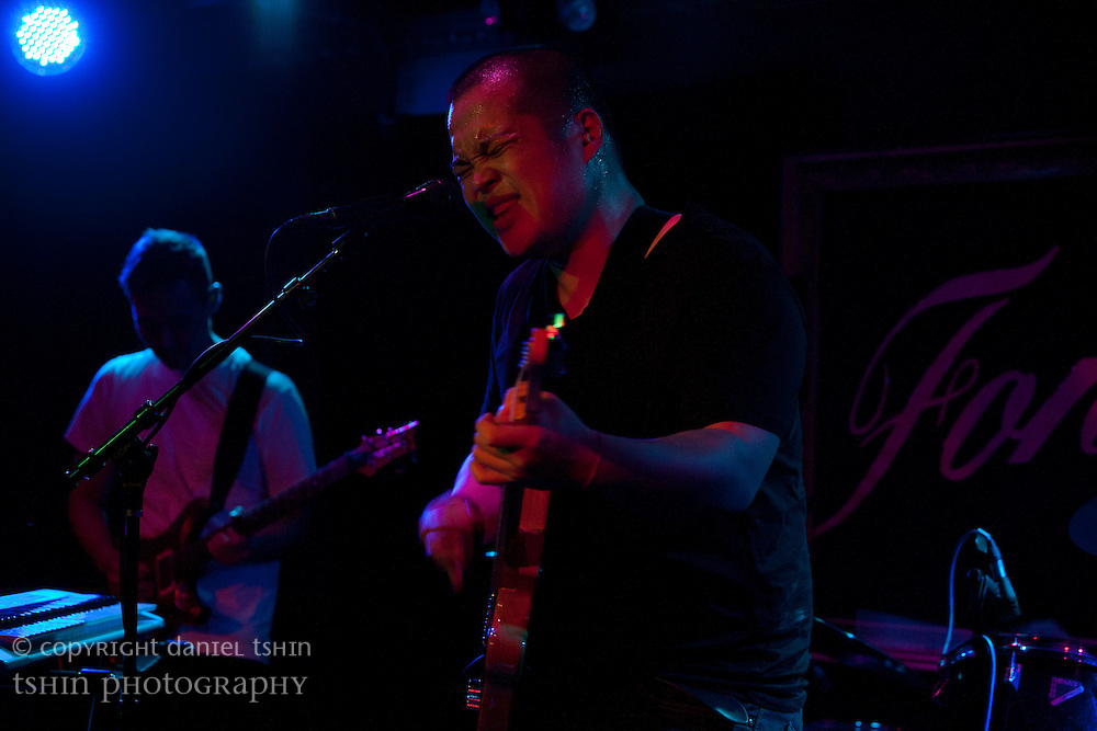 Jon Ho, vocalist and guitarist of Deacons Hail with Jae Ko, guitarist in the background