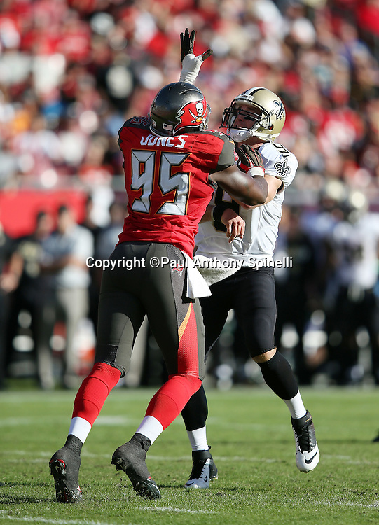New Orleans Saints quarterback Drew Brees (9) throws a pass while pressured by the outstretched hand of Tampa Bay Buccaneers defensive end Howard Jones (95) during the 2015 week 14 regular season NFL football game against the Tampa Bay Buccaneers on Sunday, Dec. 13, 2015 in Tampa, Fla. The Saints won the game 24-17. (©Paul Anthony Spinelli)